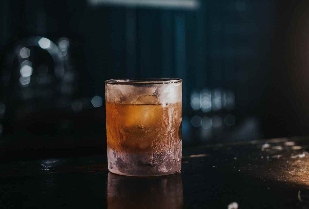 glass-on-bar-of-dark-prohibition-bar