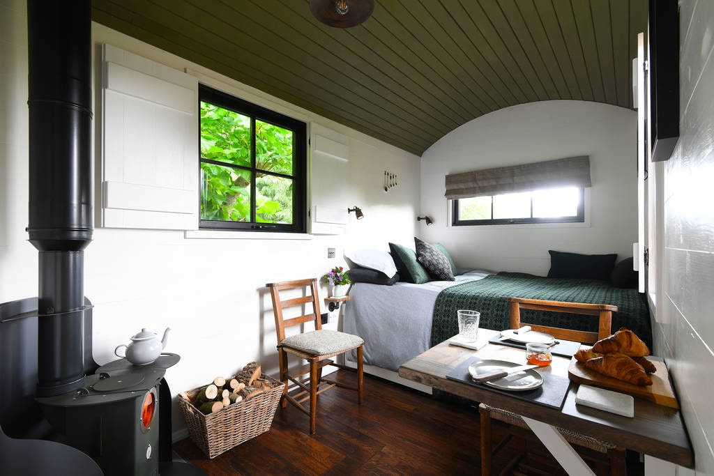 interior-of-bugail-hut-at-hide-at-st-donats-with-bed-and-living-area-glamping-south-wales