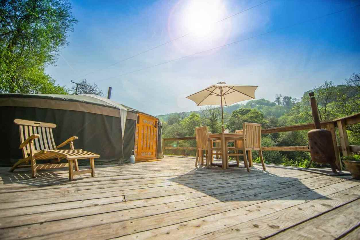 large-yurt-on-decking-on-sunny-day-at-hidden-valley-yurts-glamping-south-wales