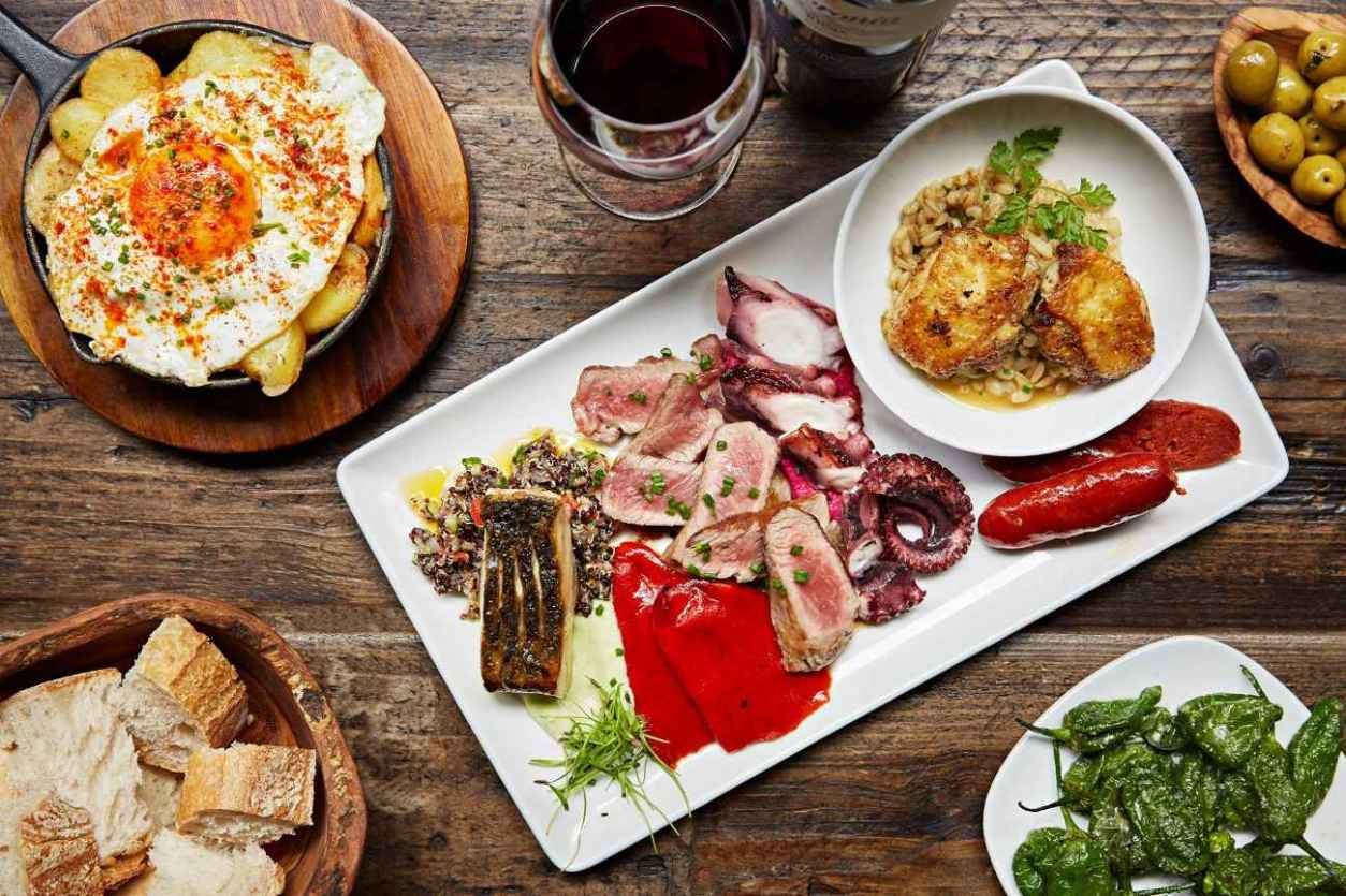 plates-of-spanish-tapas-on-restaurant-table-at-camino