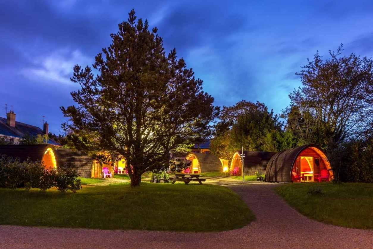 pod-umna-village-glamping-pods-lit-up-at-night-glamping-galway