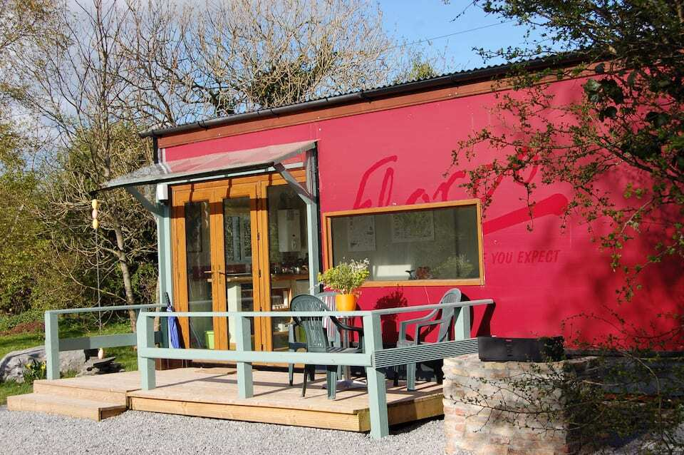 red-rural-retreat-tiny-house-with-decking