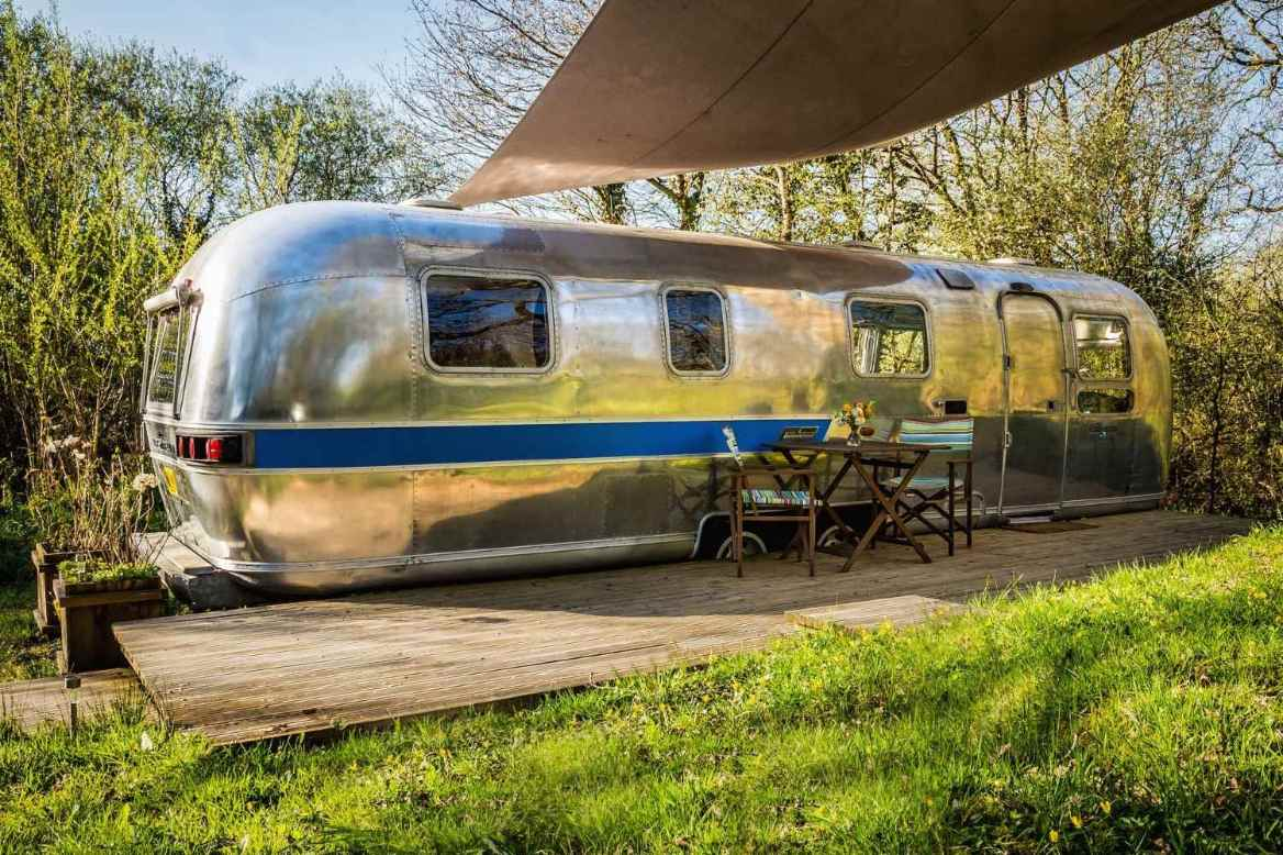 silver-the-76er-airstream-on-decking-with-seating-area