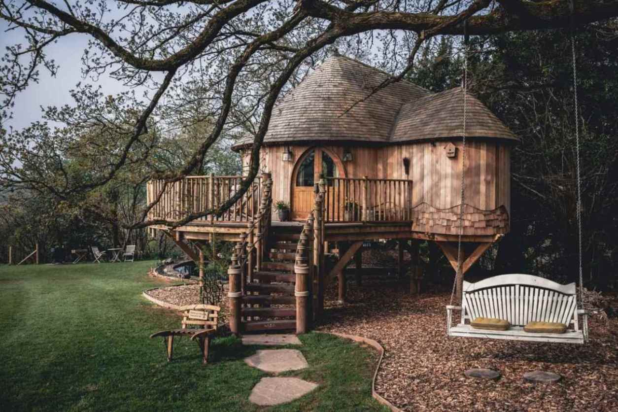 swinging-seat-outside-trewalter-treehouse-in-field-glamping-south-wales