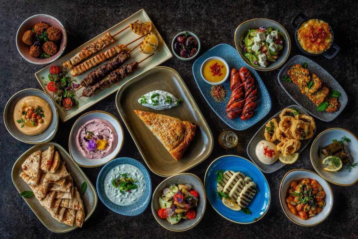 bowls-of-greek-food-on-table-at-aquum-bar