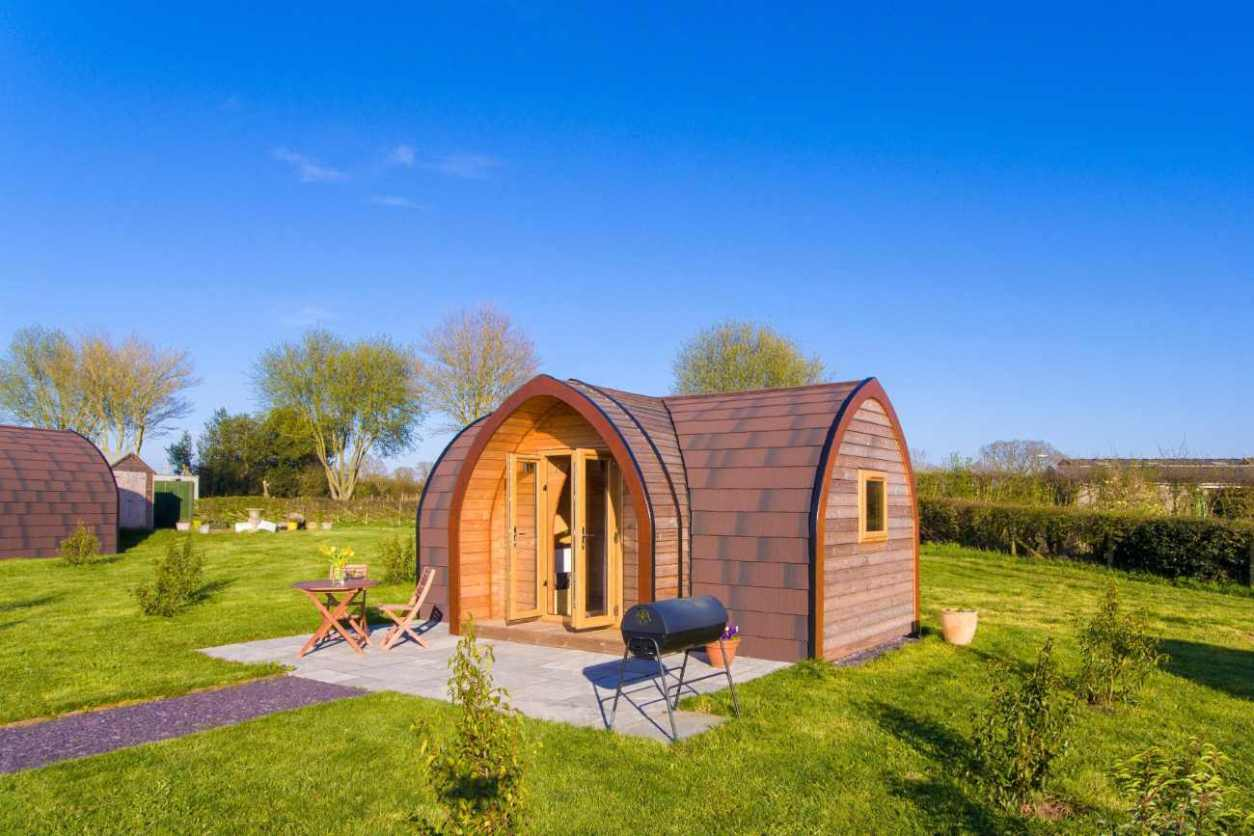 cowslip-glamping-pod-in-field-at-bradley-hall-glamping-cheshire