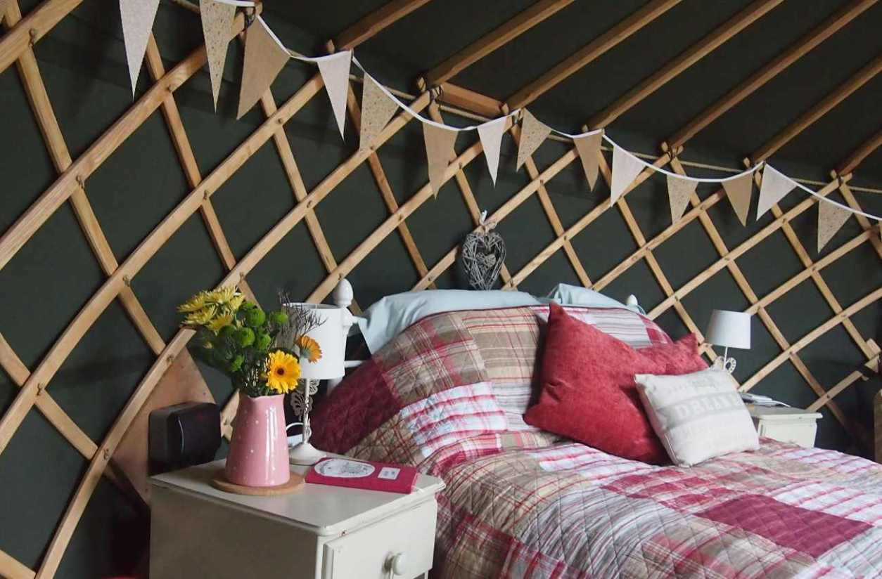 double-bed-and-bunting-inside-cheshire-farm-yurt