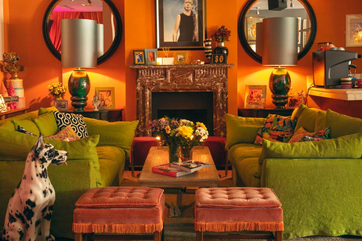 green-sofas-and-table-inside-the-little-orange-door