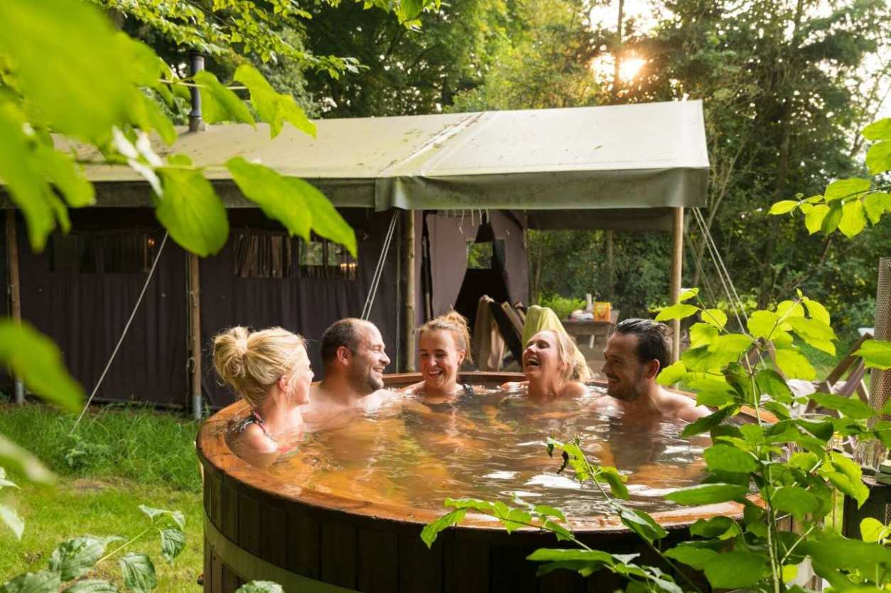 group-of-friends-in-hot-tub-at-wyresdale-park-safari-tents