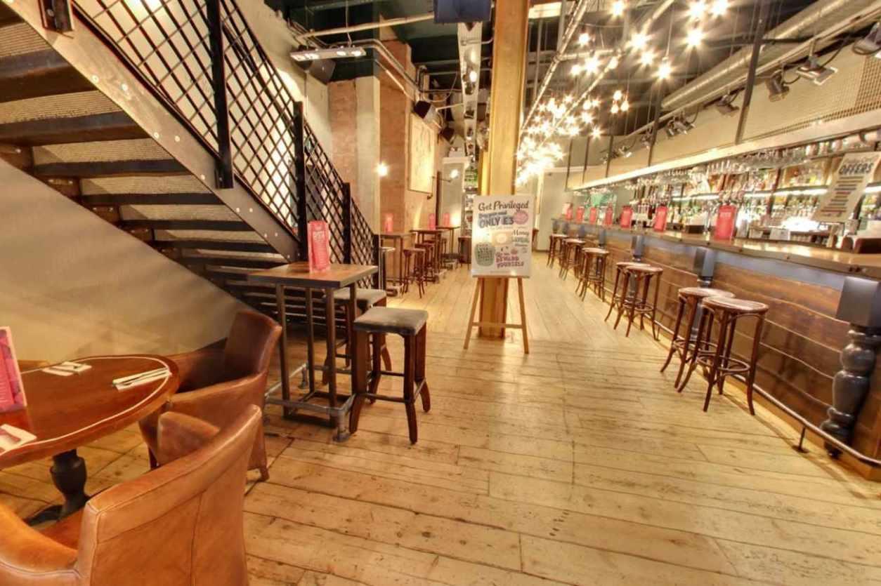 interior-of-revolution-bar-with-restaurant-seating