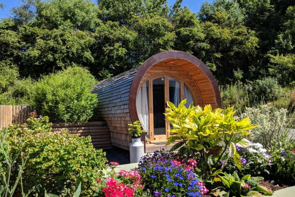 knotlow-farm-pod-surrounded-by-plants-and-trees