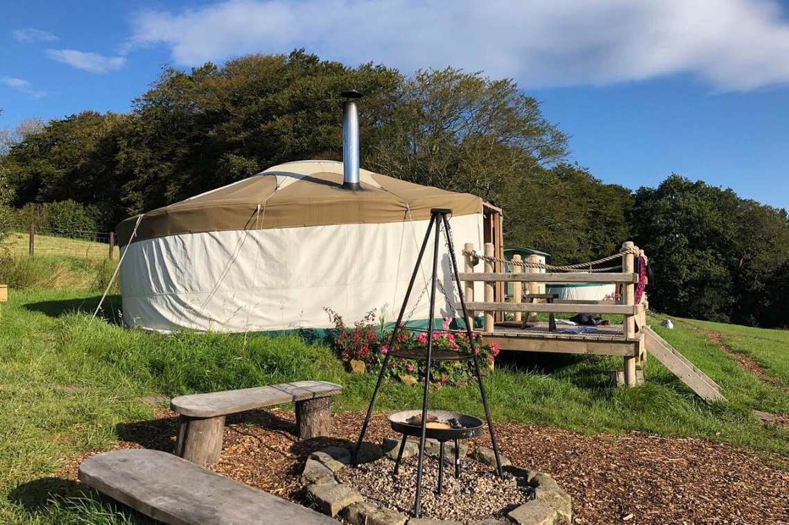 little-oakhurst-yurt-with-decking-at-top-of-field