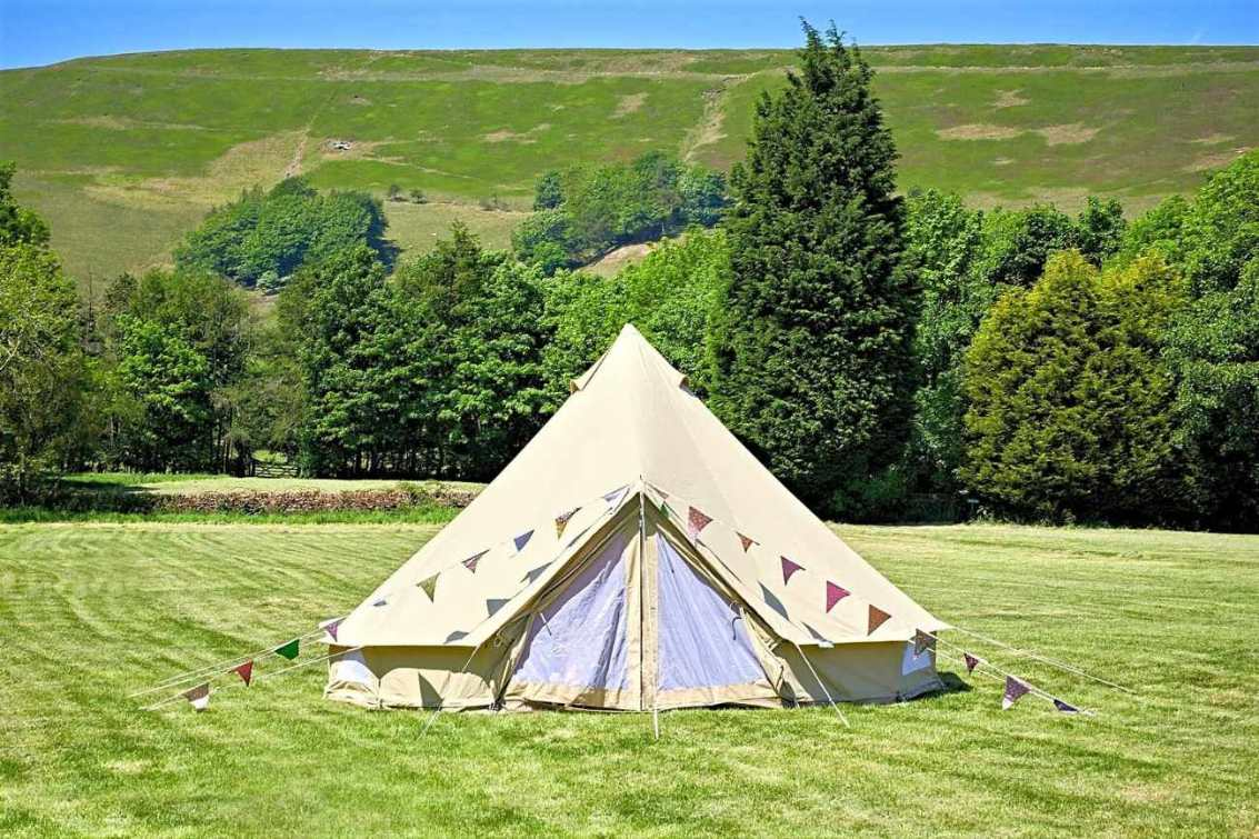 newfold-farm-bell-tent-in-field-with-hills-in-background