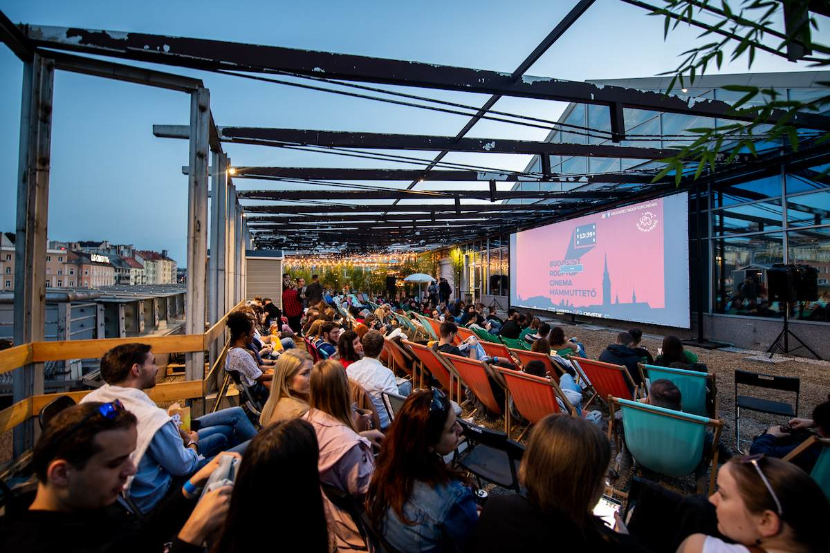 people-watching-a-film-at-budapest-rooftop-cinema-at-sunset