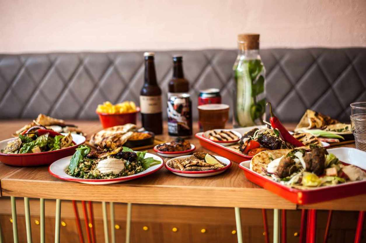 plates-of-food-and-drinks-on-restaurant-table-at-bababoom