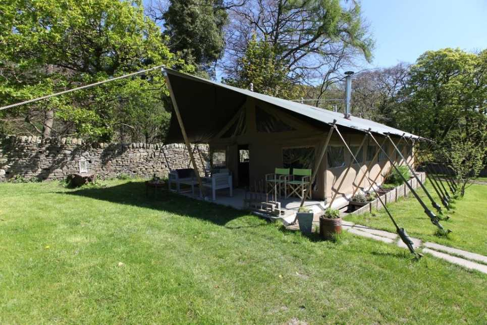 the-gathering-safari-tent-in-field-on-sunny-day