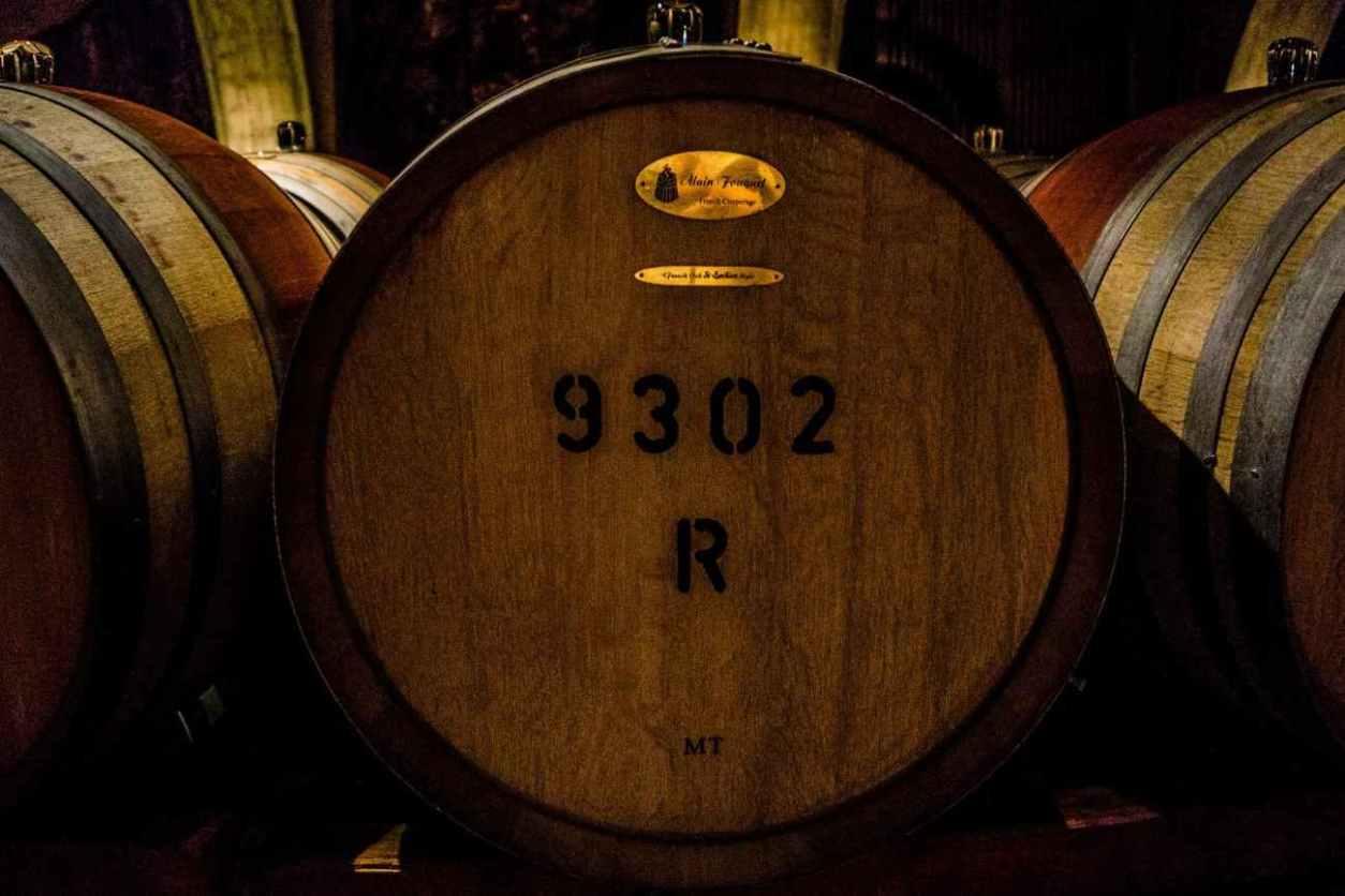 three-wine-barrels-in-dark-room
