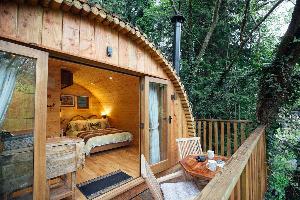 bedroom-and-decking-of-squirrels-nest-treehouse-glamping-gloucestershire