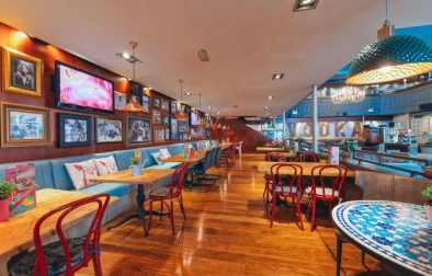interior-of-revolution-bar-with-restaurant-tables-bottomless-brunch-cheltenham