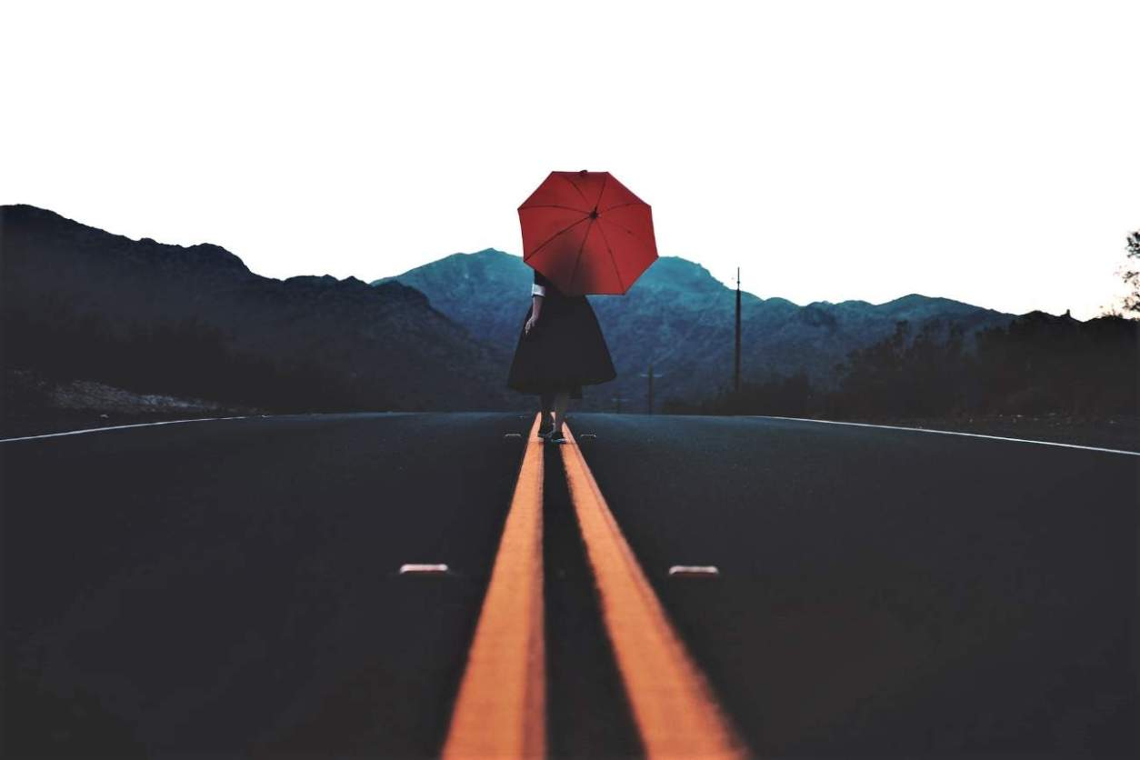 woman-with-red-umbrella-stood-in-the-middle-of-road