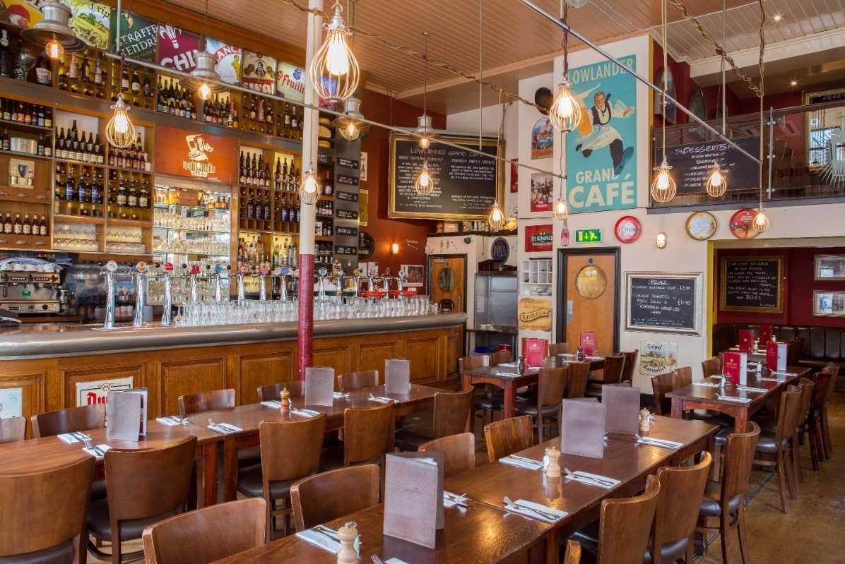 bar-and-tables-inside-lowlander-grand-cafe