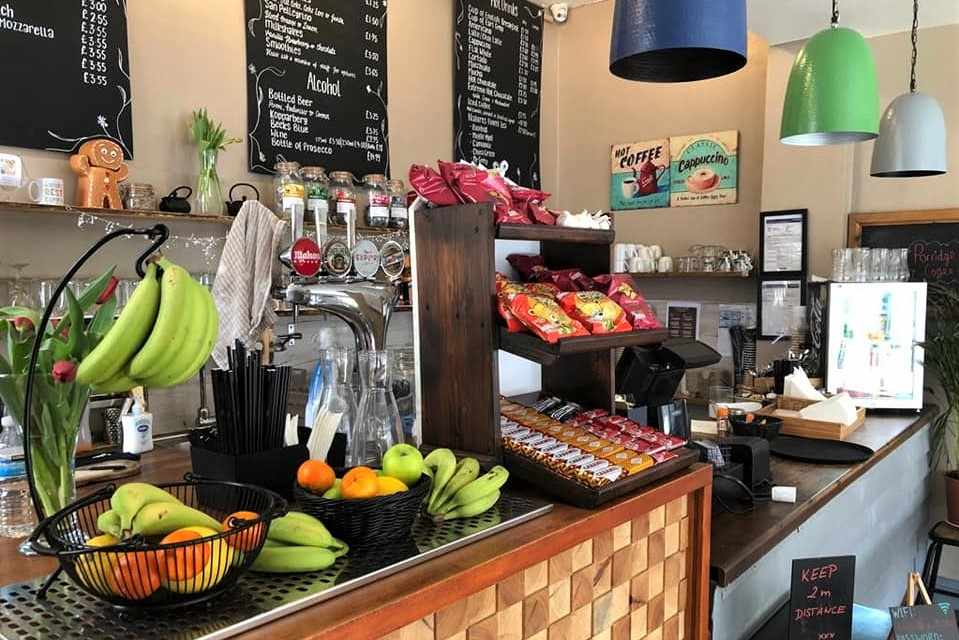 counter-of-caffee-oro-cafe-with-fruit-chocolate-and-crisps