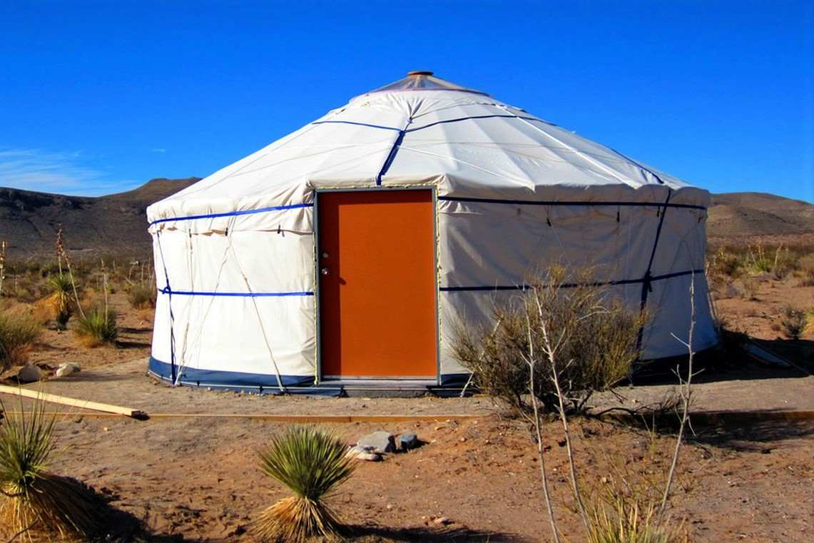 exterior-of-el-paso-yurt-on-sunny-day-in-desert