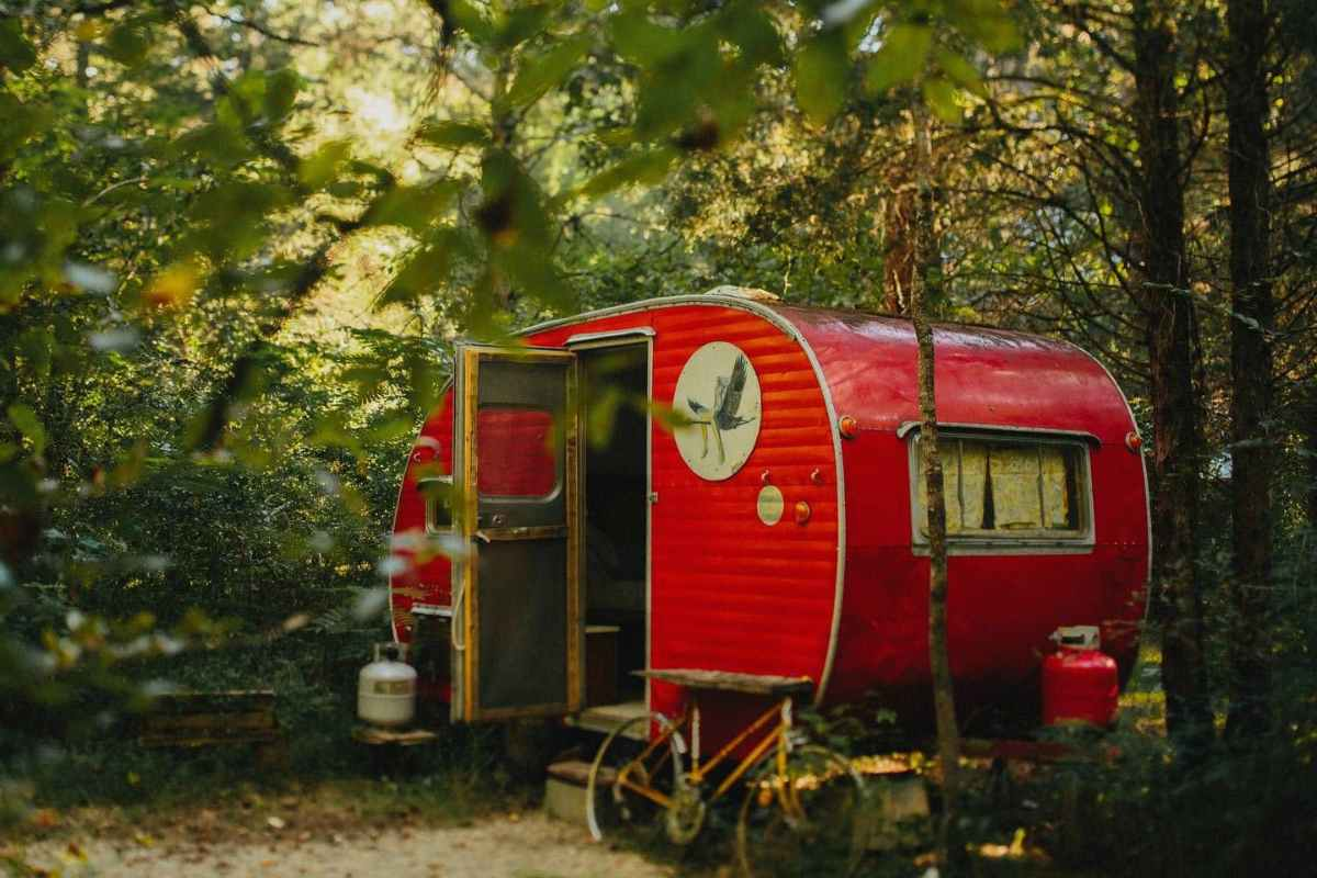 exterior-of-red-camp-grits-campervan-in-woodland