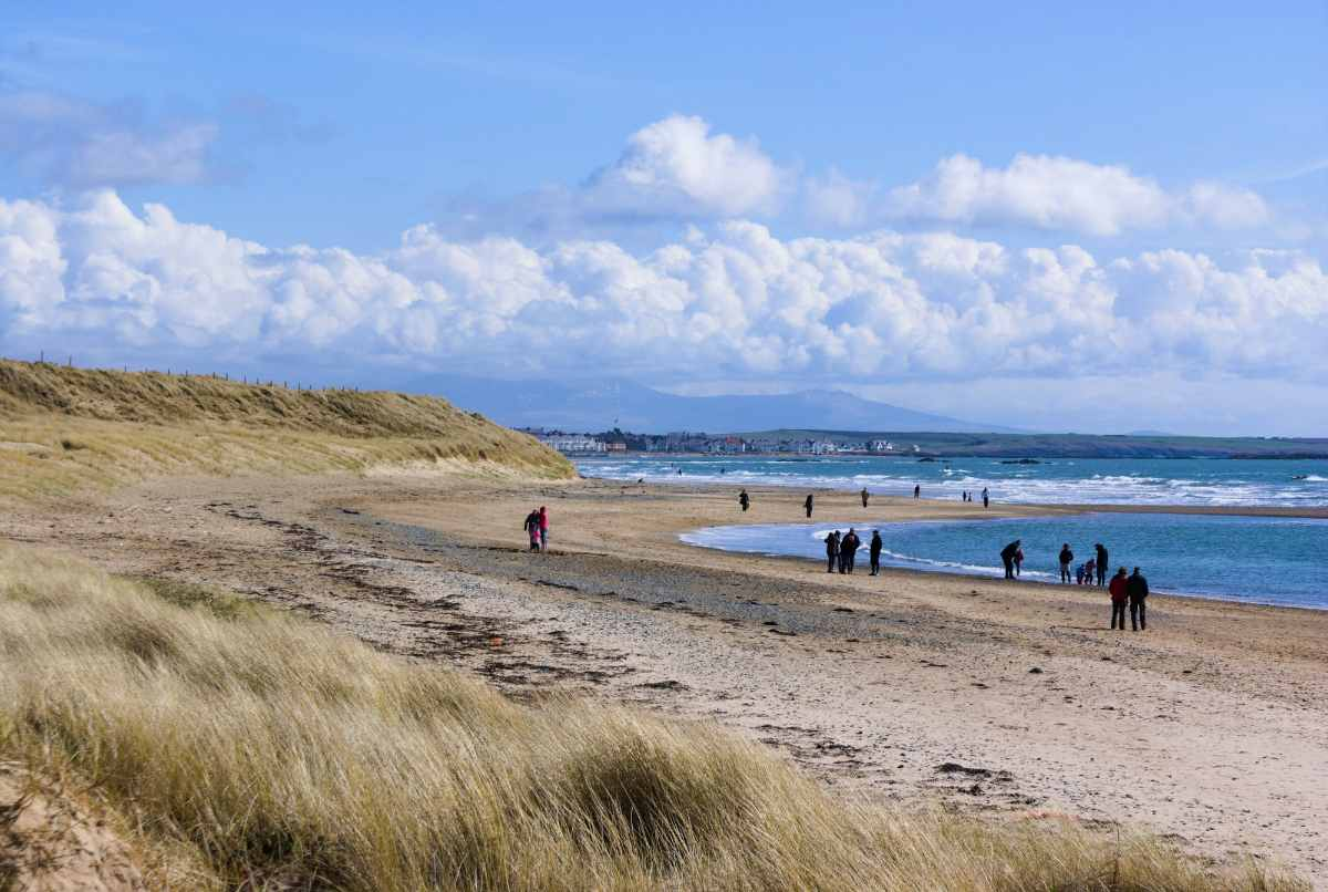 people-walking-down-rhosneigr-beach-beaches-in-liverpool