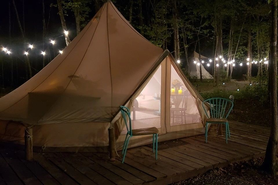 the-blue-bell-tent-lit-up-at-night-at-sassy-springs-retreat