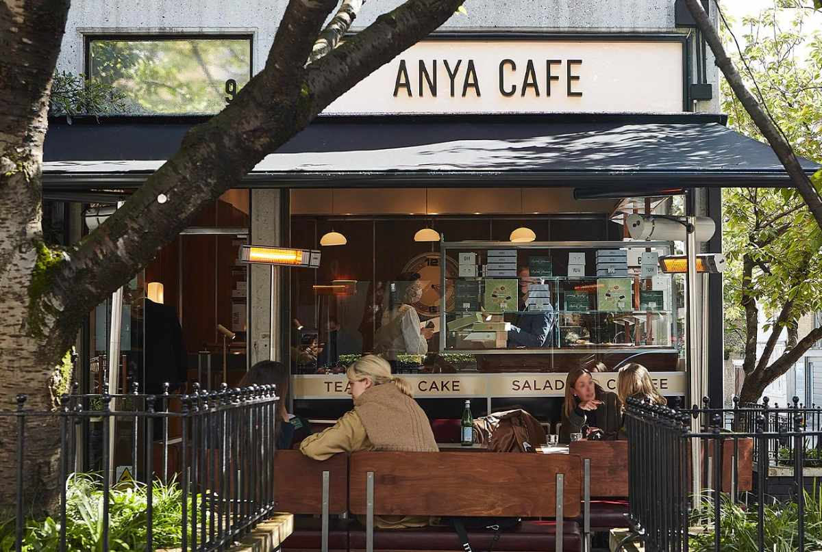 people-eating-on-tables-outside-anya-cafe
