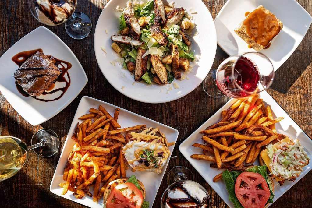 plates-of-food-at-creole-and-glasses-of-wine-on-14th-restaurant-bottomless-brunch-dc