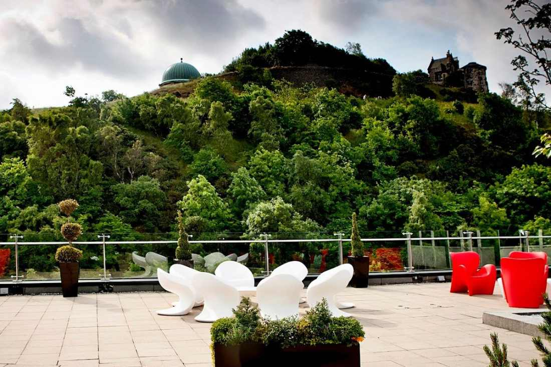 seats-on-the-glasshouse-hotel-roof-garden-by-trees