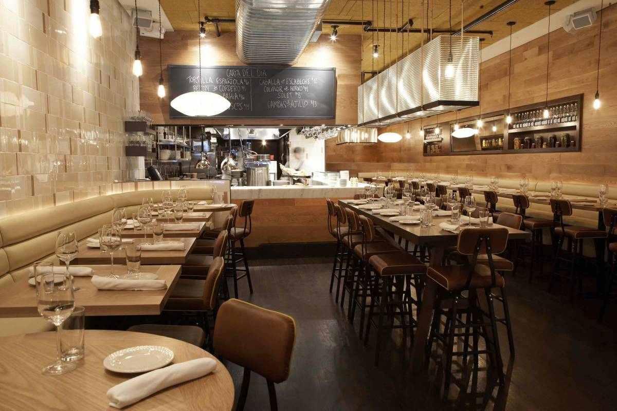 tables-and-kitchen-inside-boqueria-restaurant