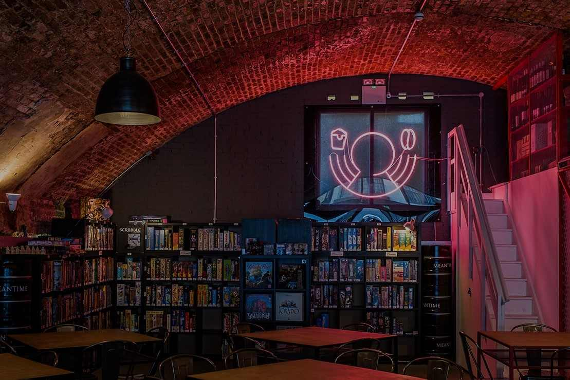 wall-of-board-games-in-draughts-board-game-cafe