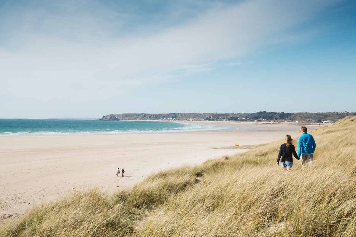 couples-walking-down-st-ouens-bay-3-days-in-jersey-itinerary