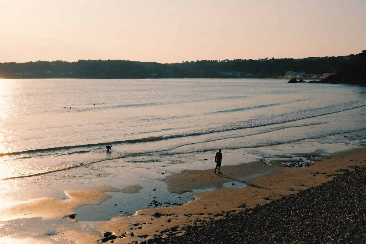 man-walking-down-beach-at-sunset-3-days-in-jersey-itinerary