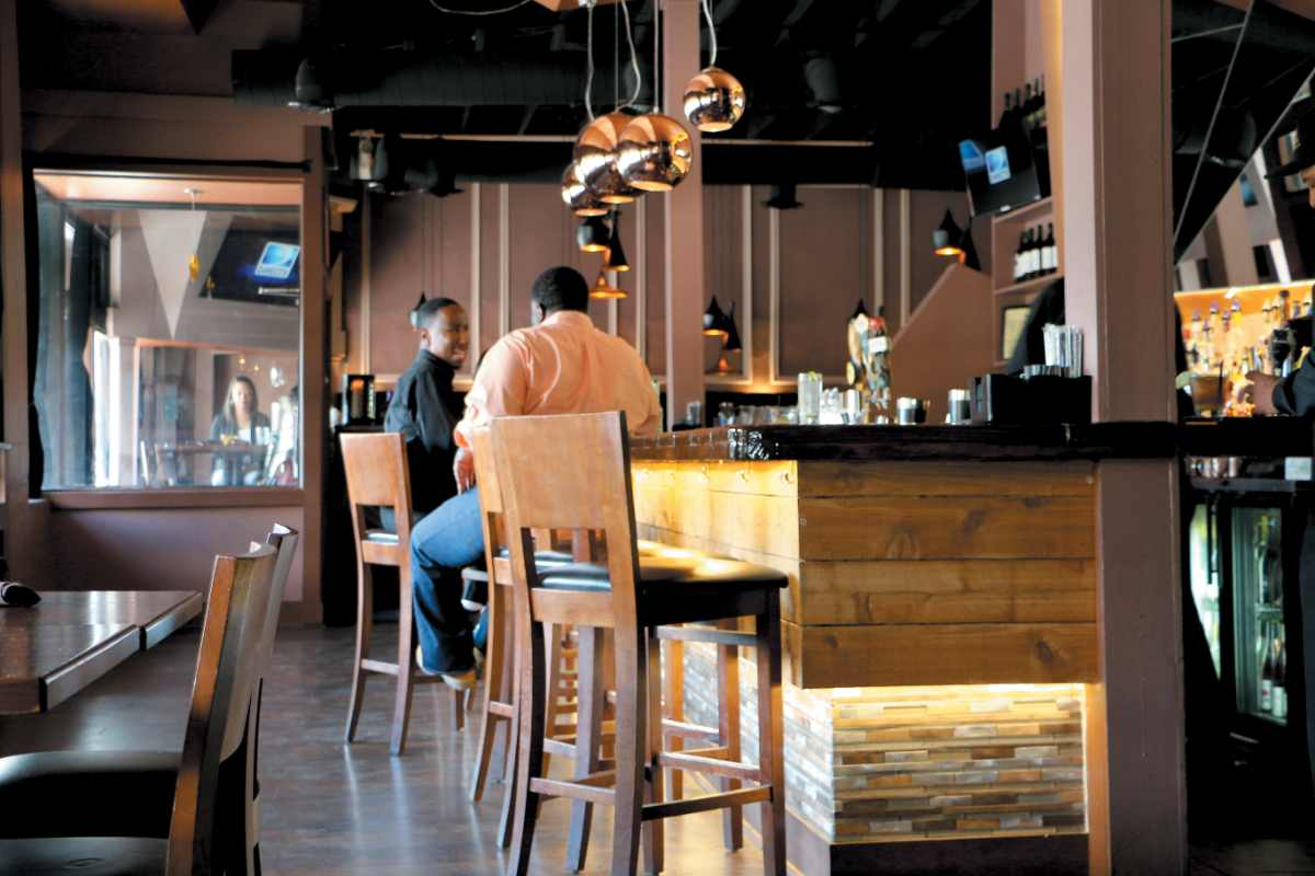 two-friends-drinking-at-bar-of-BQE-restaurant-and-lounge