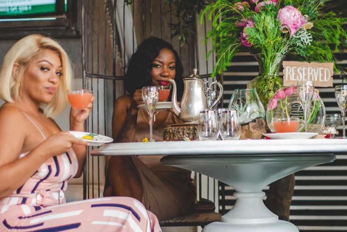 two-friends-drinking-at-garden-parc-bottomless-brunch-atlanta