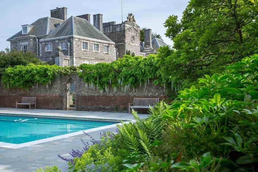 swimming pool with farleigh house as backdrop