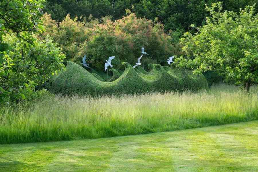 Farleigh Wallop Estate & garden - avian sculptures by Diane Maclean and yew waves created by Andrew Woolley.