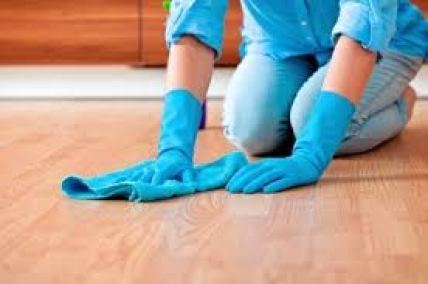 cleaning floor on hands and knees