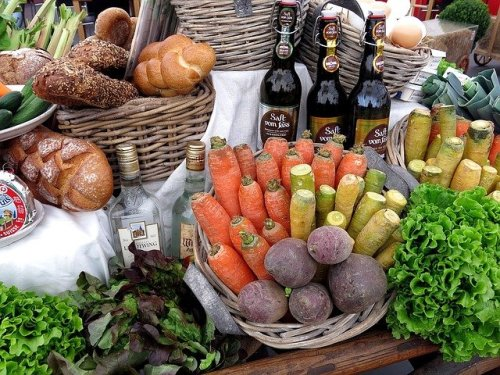 Bread, vegetables, wine and other fresh farm food.