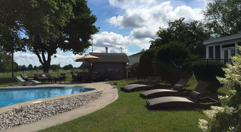 Swimming pool at Mountain Ash Farm, A Farm stay & spa hotel in Creemore, Ontario.