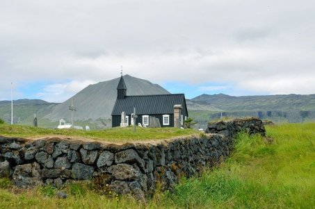 Church with mountains behind at Snaefellsjokull National Park in Iceland