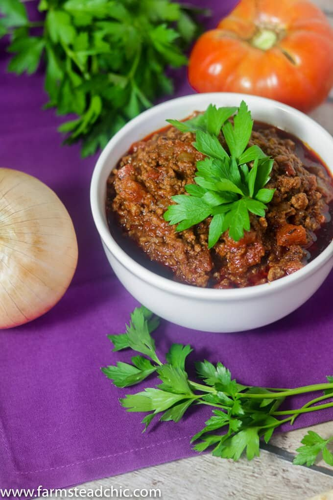 Paleo and Whole30 Chili in a white bowl on a purple cloth