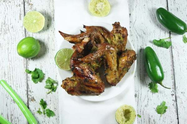 This Whole30 and Paleo Jalapeño Chicken Marinade is perfection! Spicy, fresh and tangy, it is a great complement to grilled chicken wings!