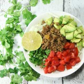These Whole30 and Paleo compliant Taco Salad Bowls are a healthy, quick and easy, fresh and flavorful, completely customizable weeknight meal fit for the whole family!