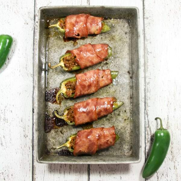 Beefy, creamy, wrapped in bacon and easy to make, these Paleo and Whole30 Jalapeño Poppers are the perfect Super Bowl party snack!