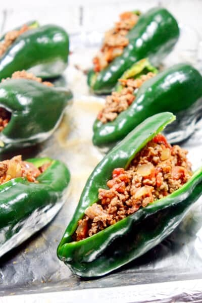 These Paleo and Whole30 Stuffed Poblano Peppers are completely freakin' out of this world delicious, a no-brainer to make, and healthy to boot.